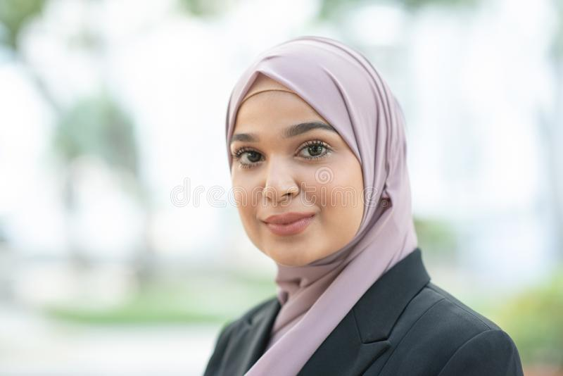 Muslim woman in business suit stock photography