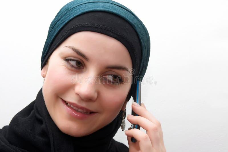 Muslim woman cell phone stock photo