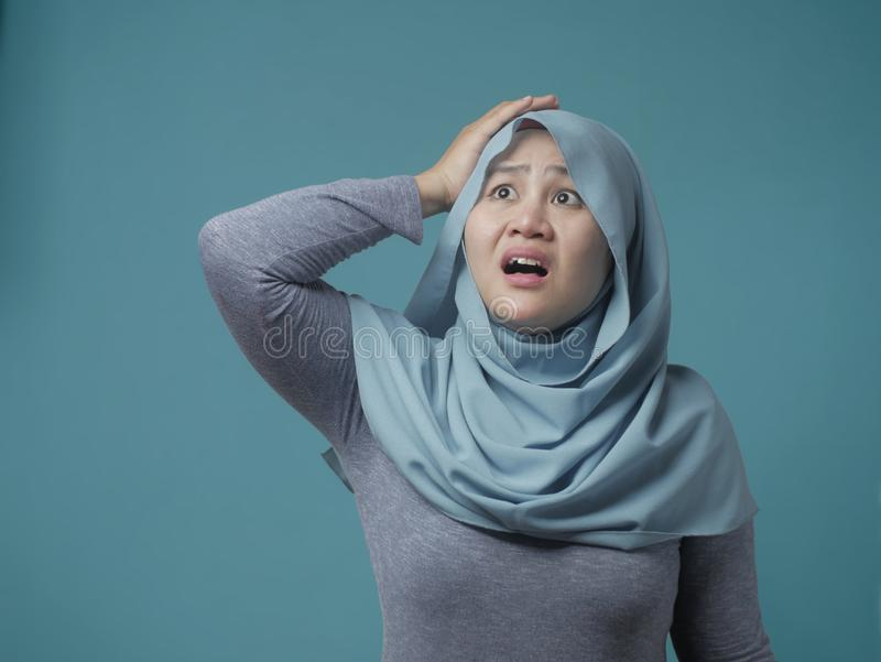 Muslim Woman Confused and Worried Gesture royalty free stock photo