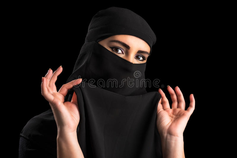Muslim woman covering face royalty free stock image