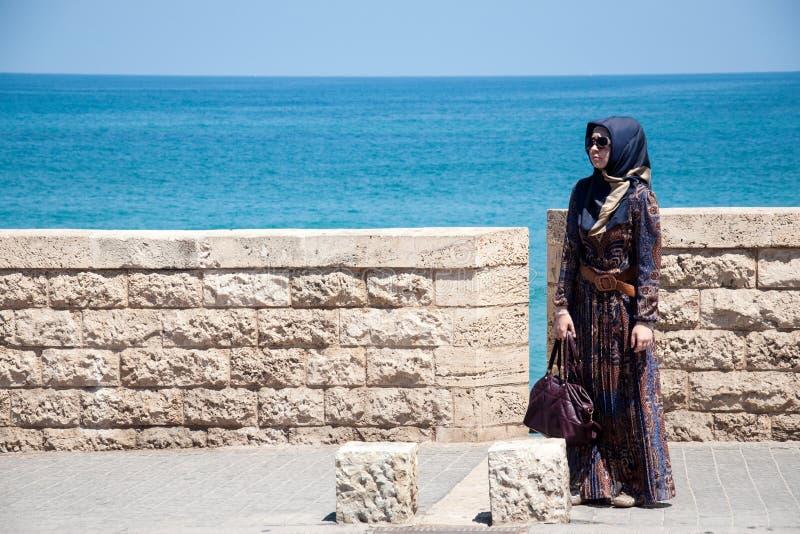 Muslim woman on the embankment of Tel Aviv, Israel royalty free stock images