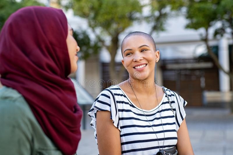 Muslim woman with friend stock image