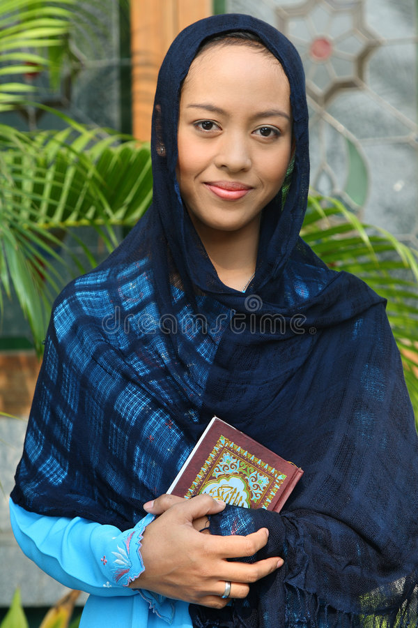Download Muslim Woman Holding Qur'an Stock Photo - Image: 7000092