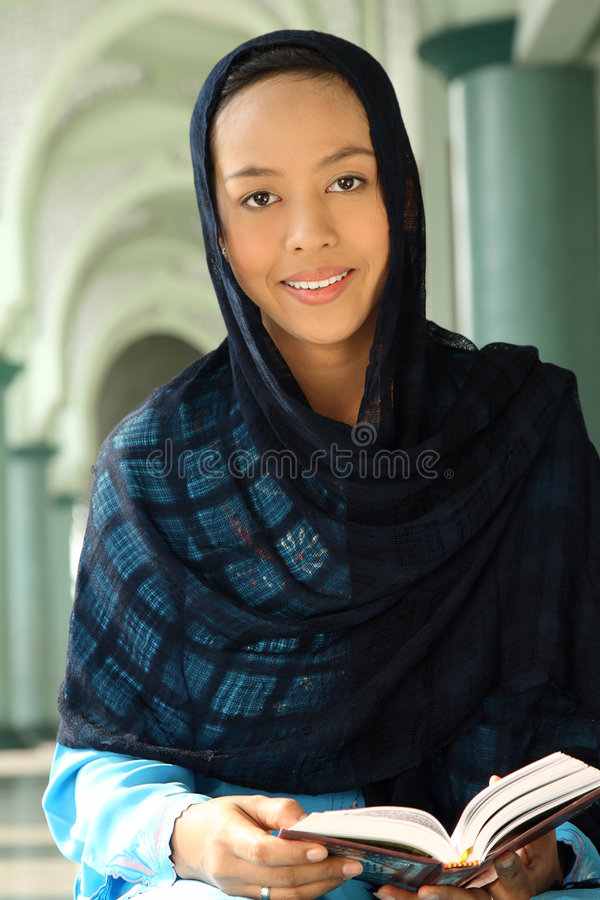 Download Muslim Woman Holding Qur'an Stock Image - Image: 7000109