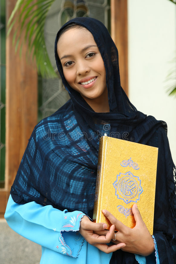 Download Muslim Woman  Holding Qur'an Stock Image - Image of smile, pretty: 7000265