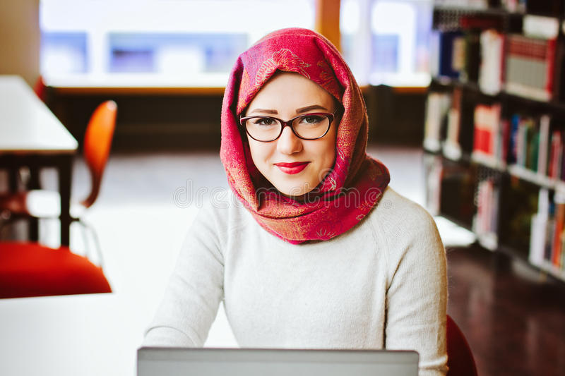 Muslim woman at the library royalty free stock photography