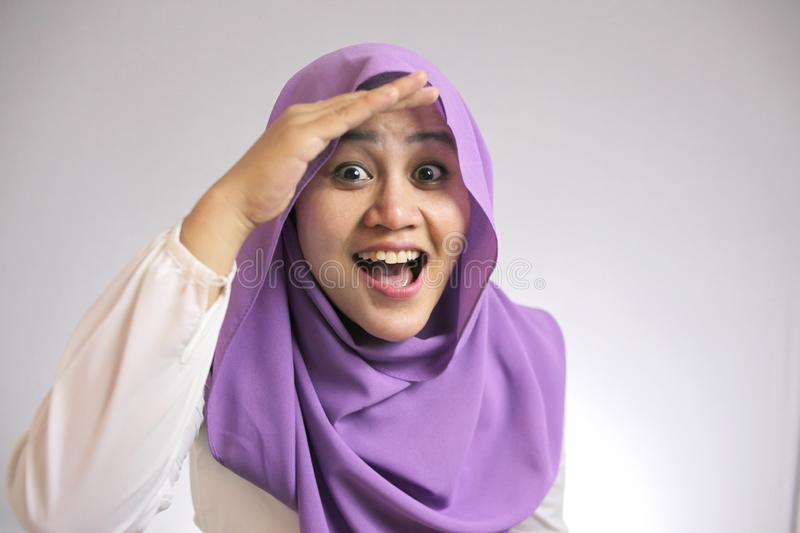 Muslim Woman Looking Far Ahead With Shocked Surprised Expression stock photography