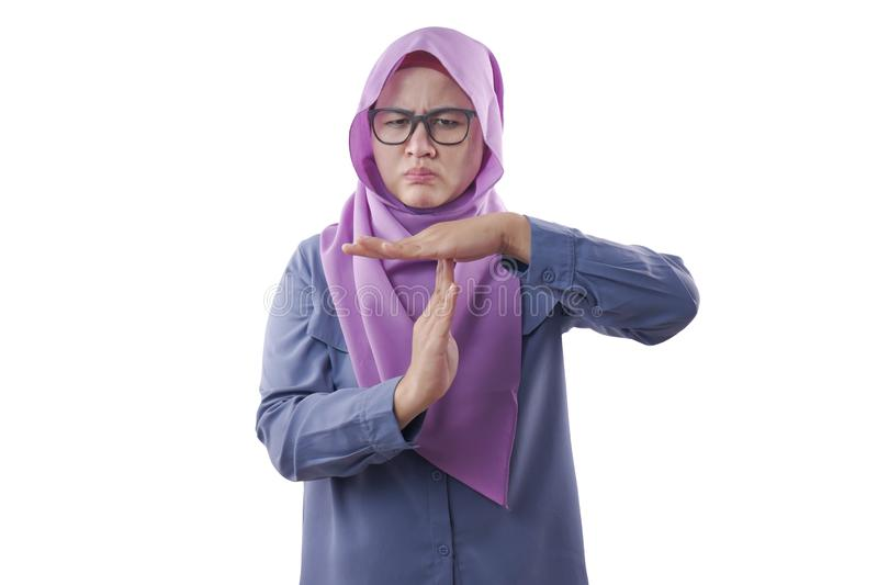 Muslim Woman Making Time Out Gesture. Portrait of mad tired angry Asian muslim woman making time out gesture isolated on white, hijab, indonesian, malaysian stock photos