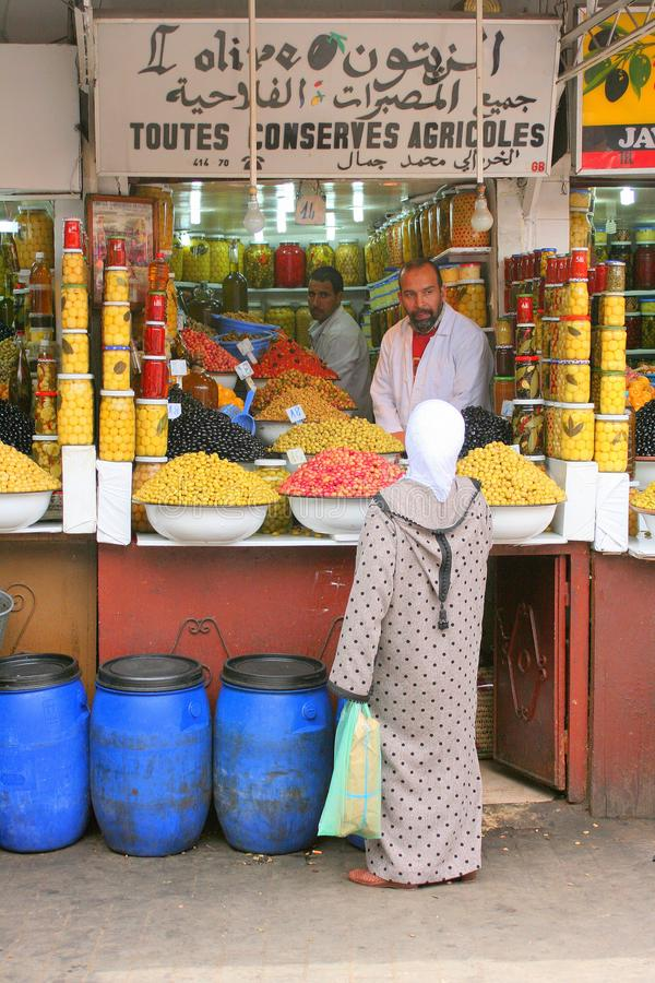Muslim woman at olive stall royalty free stock photography