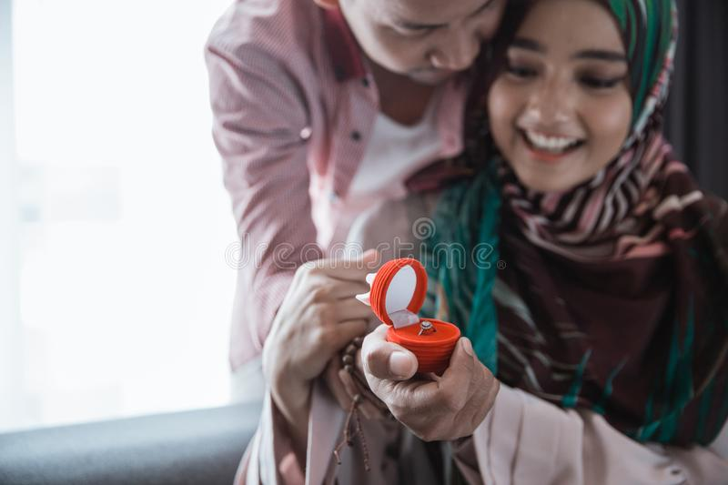 Muslim woman suprised get ring royalty free stock images