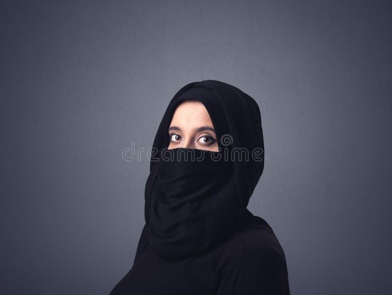 Muslim woman wearing niqab. Young muslim woman wearing niqab stock images