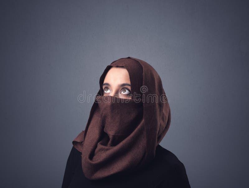 Muslim woman wearing niqab. Young muslim woman wearing niqab royalty free stock image