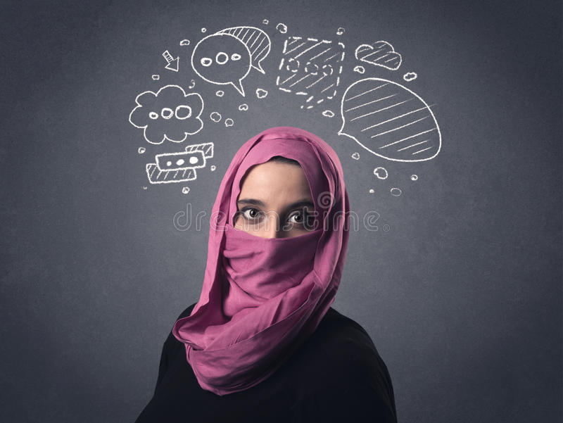 Muslim woman wearing niqab. Young muslim woman wearing niqab with drawn speech bubbles above her head royalty free stock photos