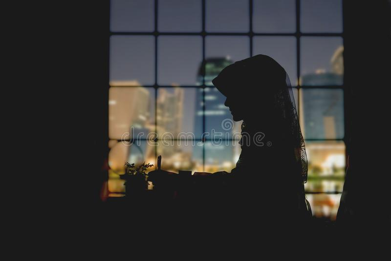 Muslim woman working in city office table silhouette royalty free stock photos