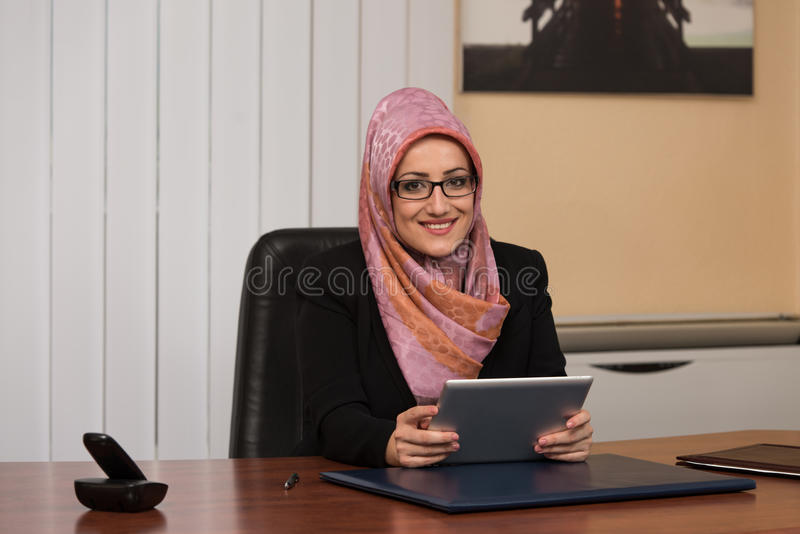 Muslim Woman Working On Computer In Office royalty free stock photo
