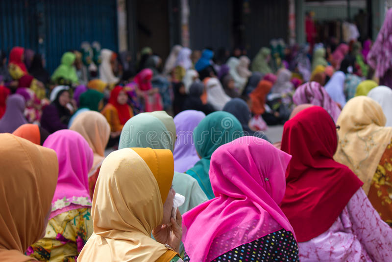 Muslim women during Friday Prayers in Kota Bharu, Malaysia. Muslim woman in colorful hijabs during Friday prayers in the Islamic City of Kota Bharu, Malaysia royalty free stock image