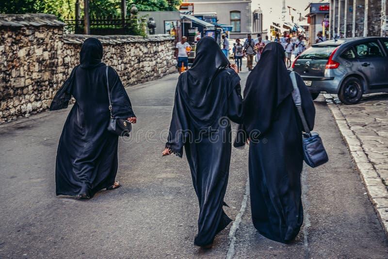 Muslim women in Mostar. Mostar, Bosnia and Herzegovina - August 25, 2015. Three Muslim women walks on street in Mostar royalty free stock photo