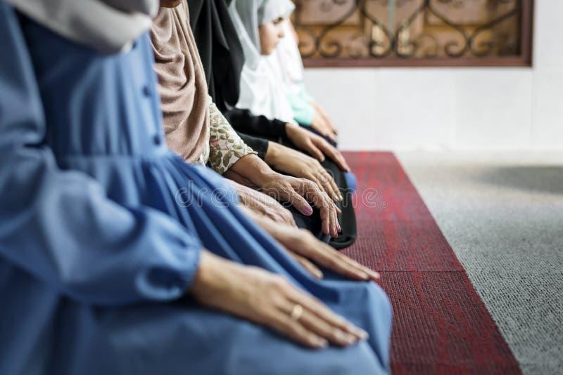 Muslim women praying in the mosque during Ramadan royalty free stock images