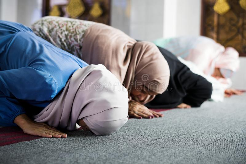 Muslim women praying in the mosque during Ramadan royalty free stock photography