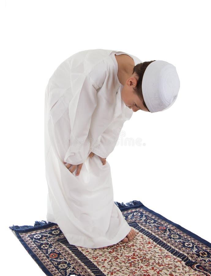 Muslim young boy praying royalty free stock image