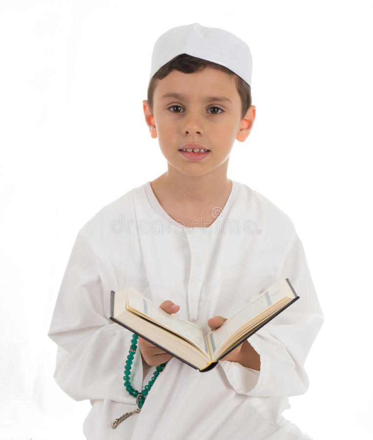 Muslim Young Boy With Quran stock image