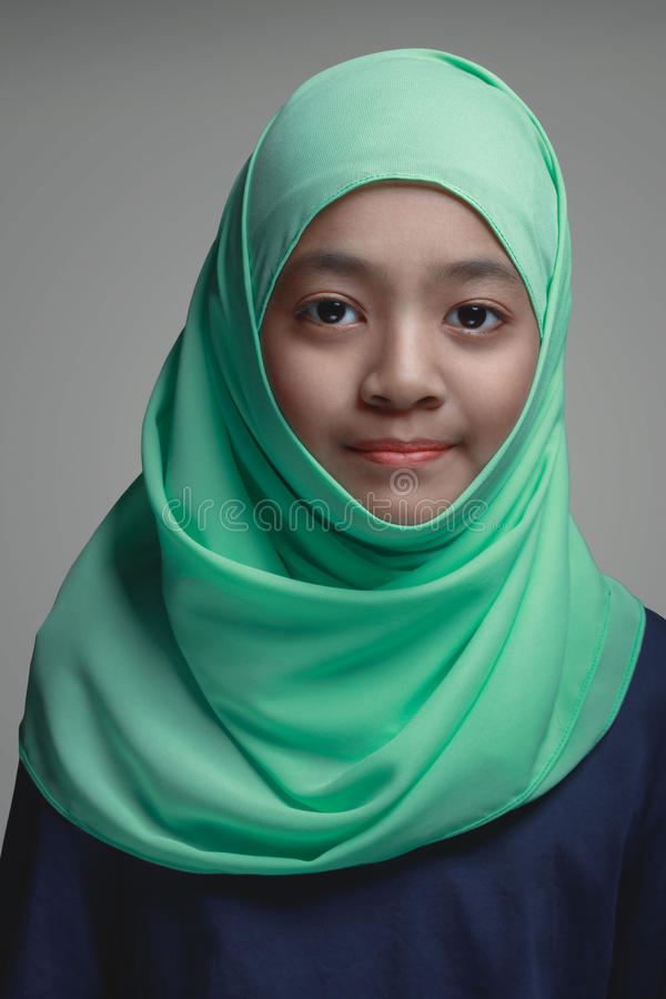 Muslim young girl,. Isolated on grey background royalty free stock photo