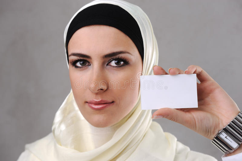 Muslim young woman with business card royalty free stock photo