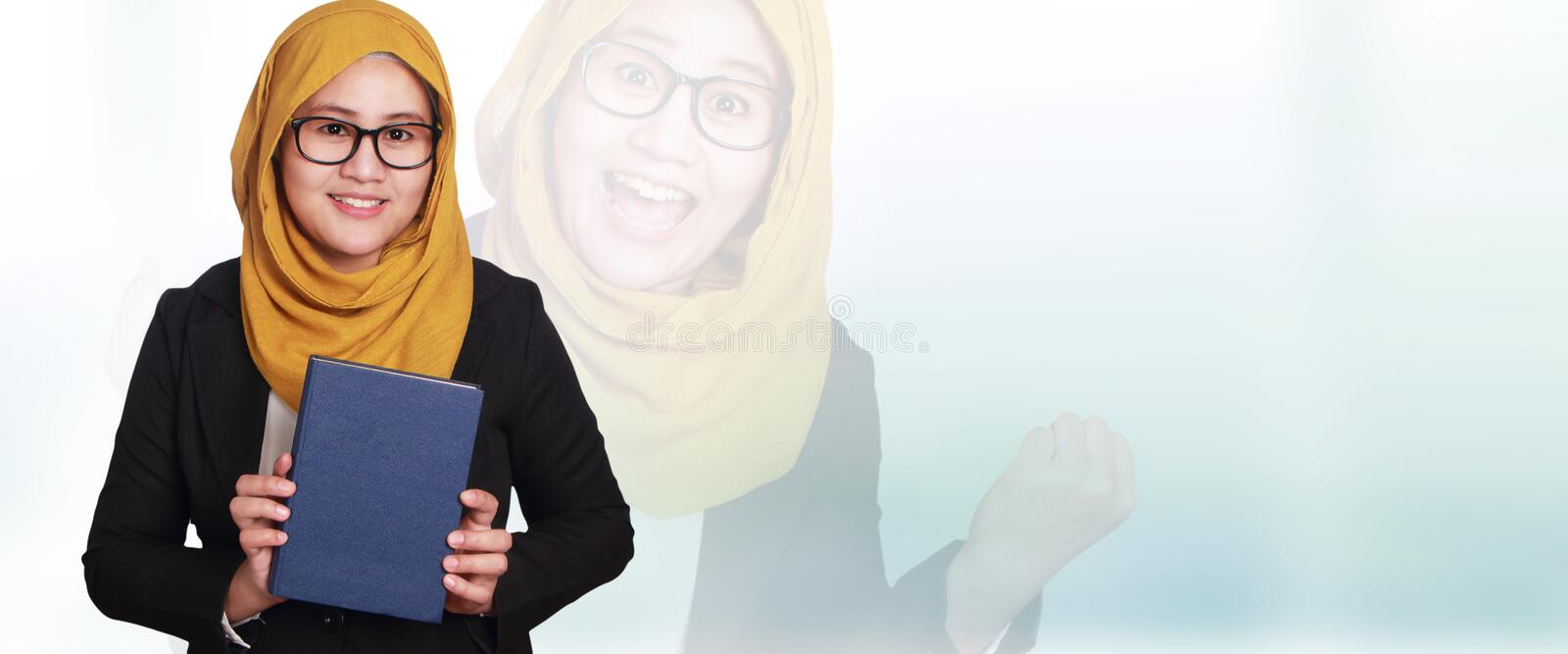 Muslimah Businesswoman Smiling, Holding Book stock images