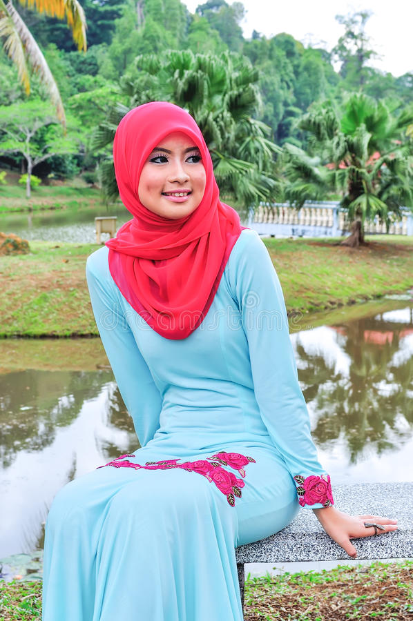 Muslimah lady wear blouse and hijab. Beautiful muslimah lady wear blouse and hijab posing at garden royalty free stock images