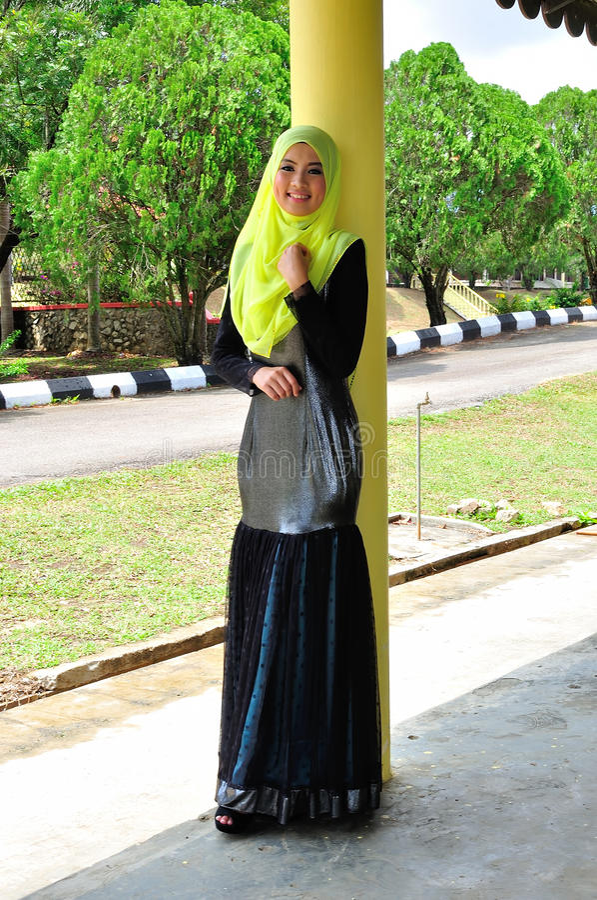 Muslimah lady wear blouse and hijab. Beautiful muslimah lady wear blouse and hijab posing at garden royalty free stock photo
