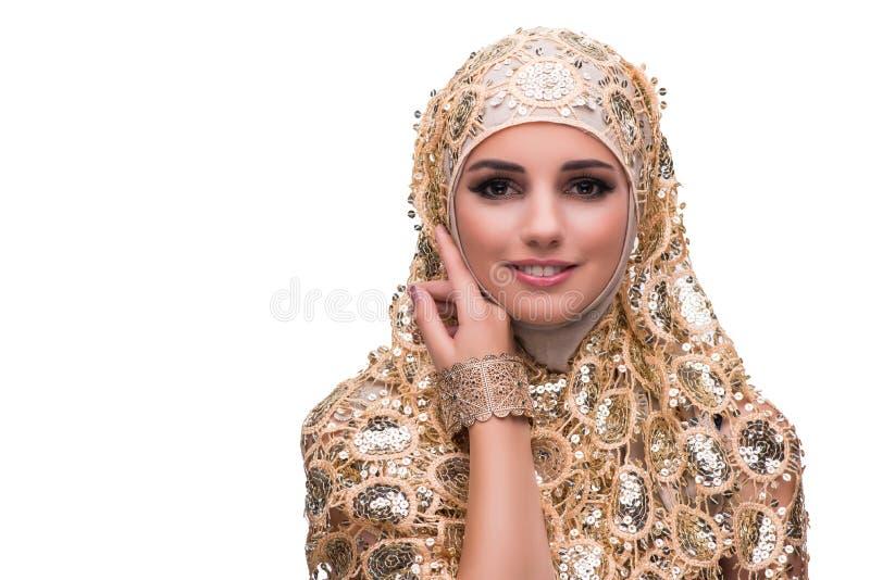 Muslimkvinnan i den guld- räkningen som isoleras på vit arkivfoto
