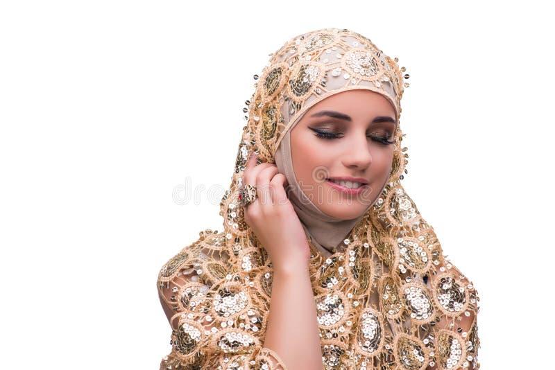 Muslimkvinnan i den guld- räkningen som isoleras på vit arkivbild