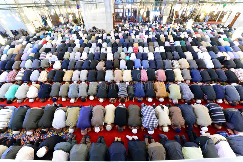 Muslims pray in the mosque Fatih. ISTANBUL, TURKEY - MAY 17: noon prayer in congregation male Muslims Fatih Mosque on May 17, 2014 in Istanbul, Turkey. Prayer is stock images