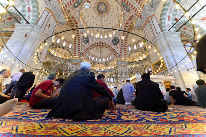 Muslims pray in the mosque Fatih. ISTANBUL, TURKEY - MAY 17: noon prayer in congregation male Muslims Fatih Mosque on May 17, 2014 in Istanbul, Turkey. Soma for stock photo
