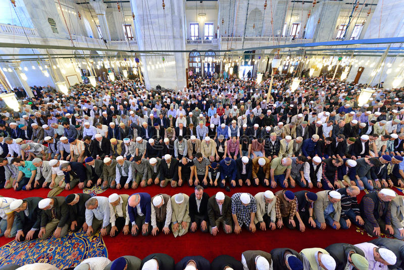 Muslims pray in the mosque Fatih. ISTANBUL, TURKEY - MAY 17: noon prayer in congregation male Muslims Fatih Mosque on May 17, 2014 in Istanbul, Turkey. Soma for royalty free stock photos