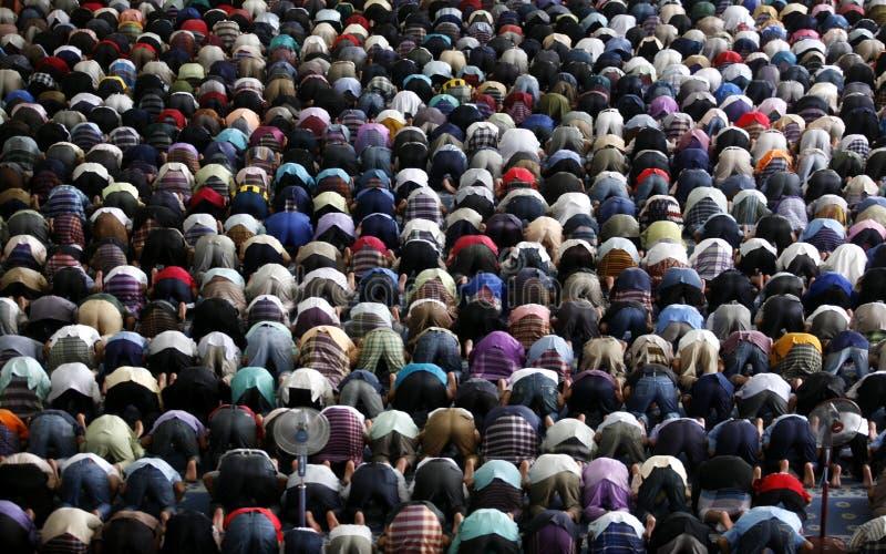 Muslims praying. A Muslim Friday mass prayer royalty free stock photo
