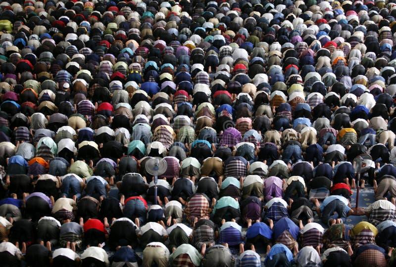 Muslims praying. A Muslim Friday mass prayer stock photos