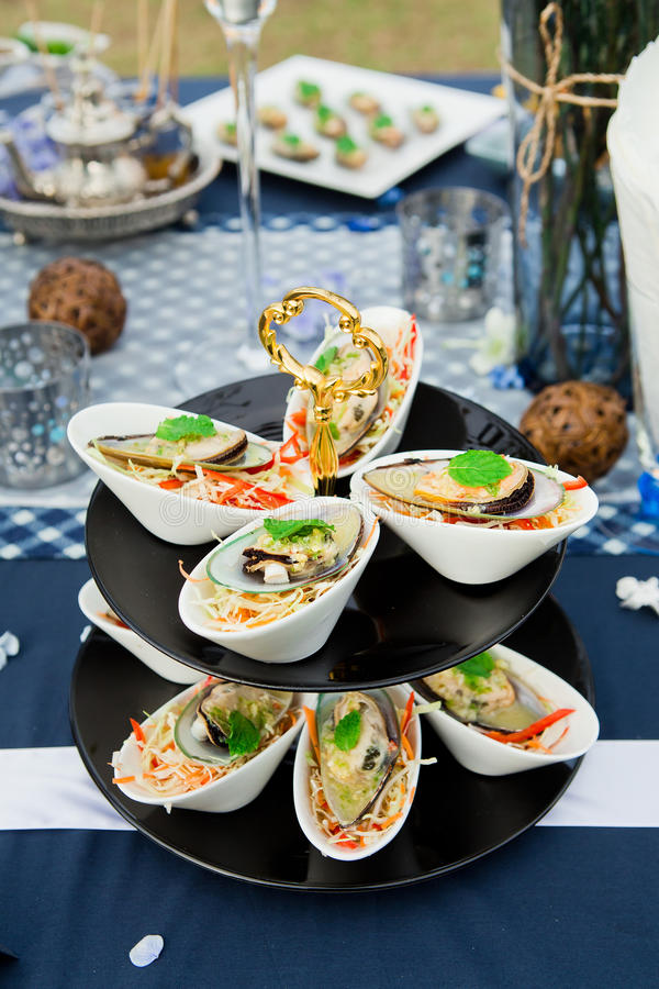Mussel cheese and garlic bread food cocktail stock image
