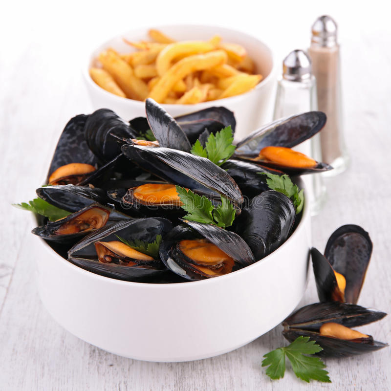 Mussel with parsley. And french fries royalty free stock photography