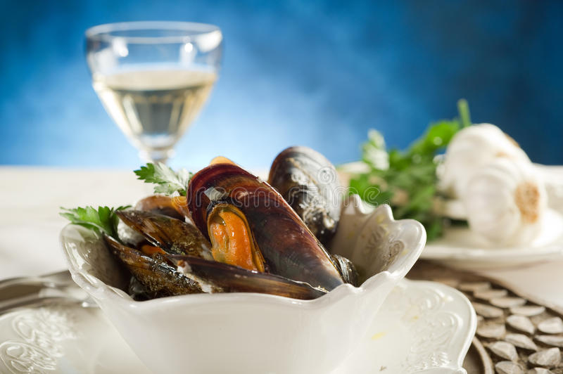 Mussel soup. With parsley and glass of wine royalty free stock photos