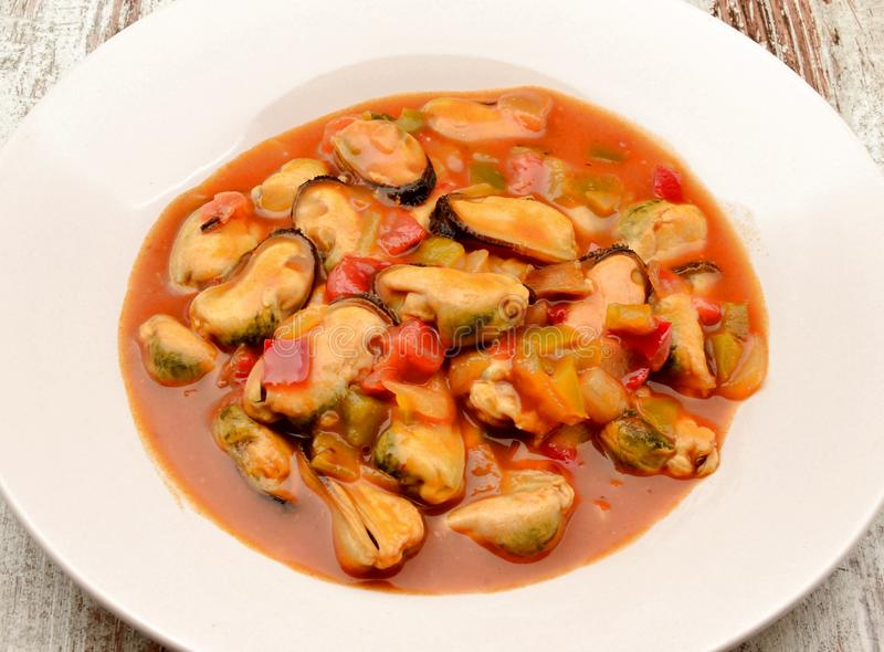 Mussel stew with tomato sauce royalty free stock photos