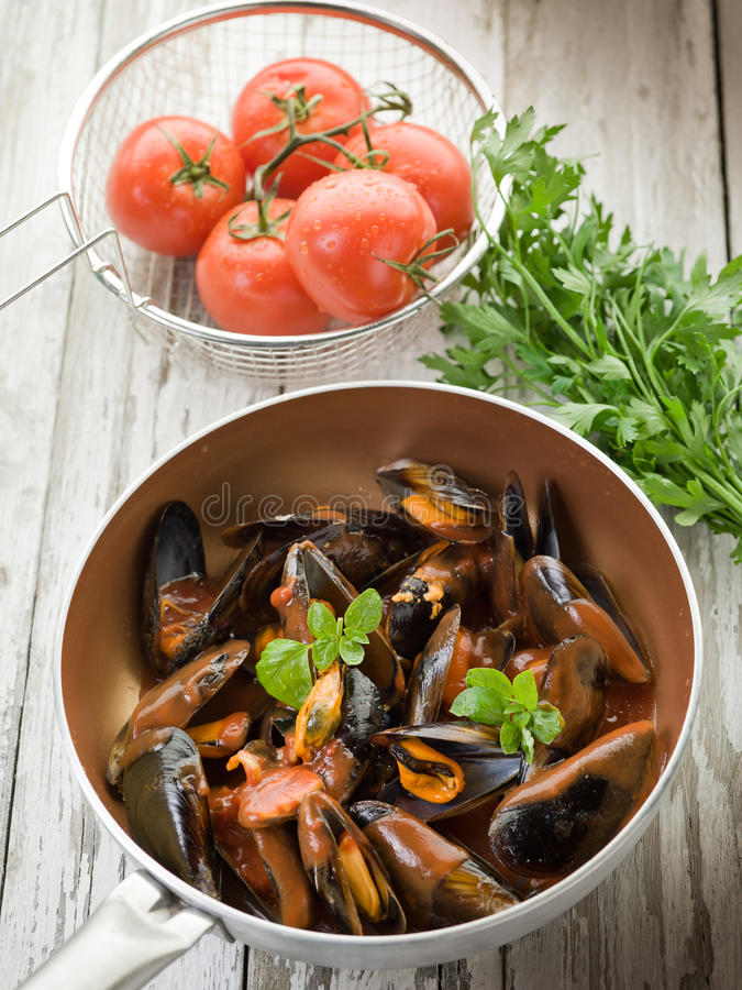Mussel with tomato sauce stock images