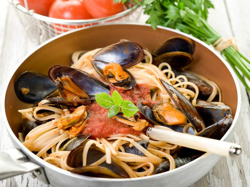 Mussel with tomato sauce royalty free stock photography