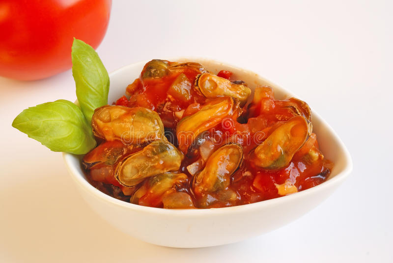 Mussels. Provencal style mussels in ceramic bowl royalty free stock photo