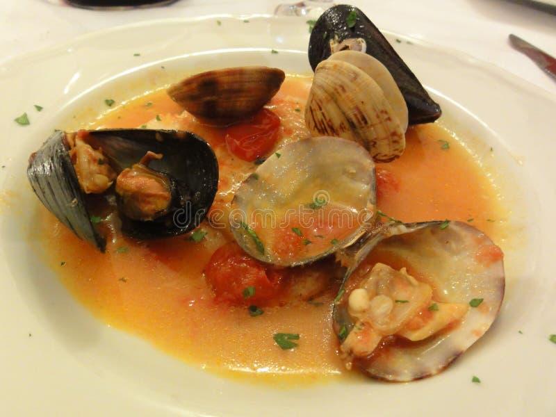 Dish of Various Shellfish in Sauce royalty free stock photos