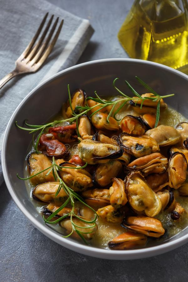 Mussels cooked with garlic, lemon and rosemary. royalty free stock photos