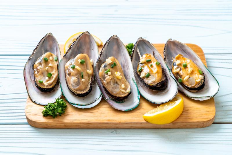 Mussels with lemon and garlic. Seafood mussels with lemon and garlic royalty free stock photo