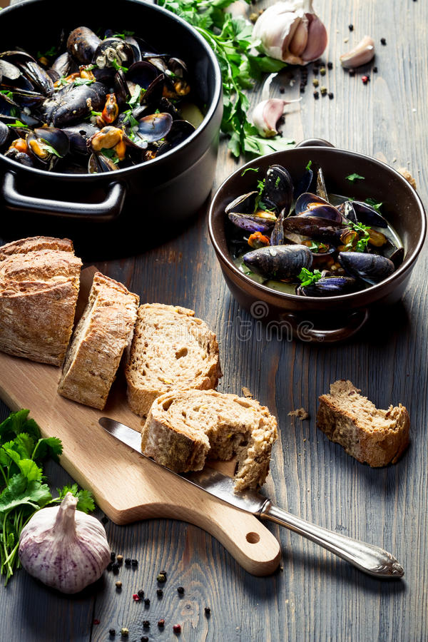 Mussels served with bread with garlic and parsley stock photos
