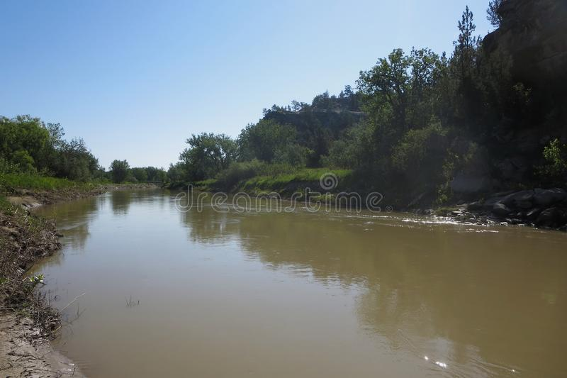 Musselshell River, Roundup, MT. The muddy Musselshell River in Roundup, MT near the fairgrounds stock image