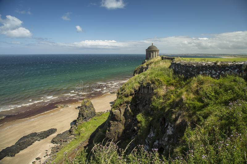 Mussenden temple and beach. Northern Ireland - Aug 01, 2017: Mussenden Temple a popular tourist attraction on the Atlantic Ocean coast of Northern Ireland stock image